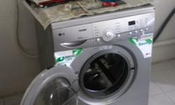 LG Washing Machine, part of Black and White house sale.
