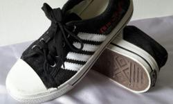 Black Canvas shoes. Stated as size 40. Physically