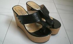 Selling a pair of almost new Black platform shoes for