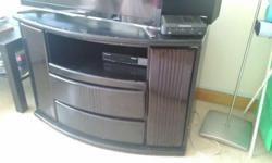 95x50x60 black glossy T.V. console in fair condition,