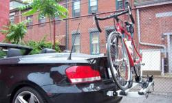 Holds 2 bicycles in a rear-mount track-carrier - bike