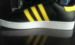 Brand new Adidas shoe for sale....A color of yellow and