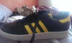 A brand new adiddas shoes is kept for sale. Anyone