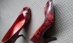 Selling a pair of MONDO peep toe heels.In a beautiful