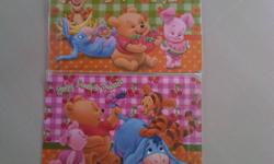 Selling 2 sets of brand new winnie the pooh table mat