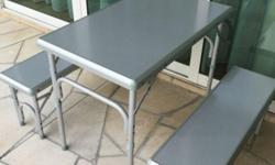 This fold-away aluminium table, with two benches,