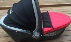 In good condition. A hard sided carry cot for newborns