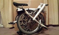 White S1L-X Titanium Brompton in Pearl White looking