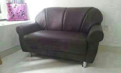 Brown color synthetic leather 2 Seater sofa for sale.