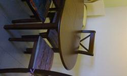 brown extendable dining set with 4 chairs. Almost new.
