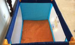 Baby cot - can be folded and stored doubles as play pen