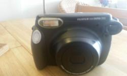 Hi! I am selling my Fujifilm INSTAX Polaroid camera at