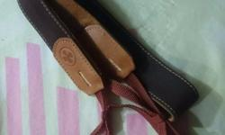 Lightly used camera neck strap Colour: Brown In good