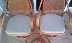 2 Cane chairs with centre table (without glass top).