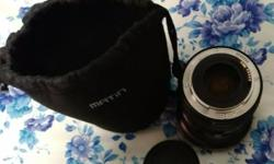 Very good condition lens. Only wording a bit fading,