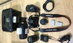 Selling this canon 500D with 18-200mm lens,10-22mm wide
