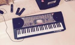 Hardly used casio keyboard with preloaded tunes and
