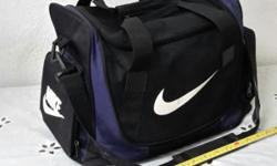 Black/blue bag. Never even bring out once before. Very