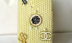 a chanel inspired casing with pearls etc in extreme