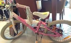 Selling girl's bike with basket due to growing up. In
