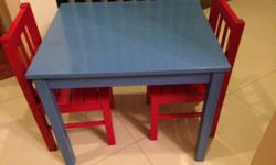 Wooden children's table with 2 chairs. New price $100.