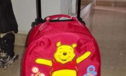 Letting go of two children travel luggage - in very