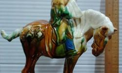 Chinese lady on a horse porcelain figurine is offered