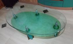 Glass coffee table with plastic stands. Good condition.