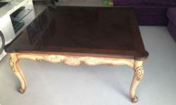 Gorgeous coffee table for sale, the table has a glass