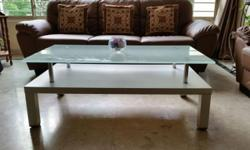 An Elegant Smoked Glass Top Coffee Table for Sale.