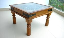 Coffee table made of wood with glass top. See through