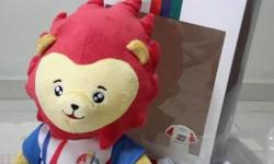 SEA Games stuffed toy with a small shirt in a box