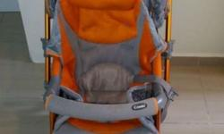 Combi stroller, orange and grey colour. Suitable for