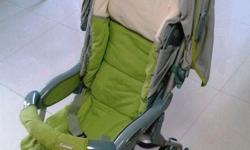Selling this used Combi stroller in green colour. Easy