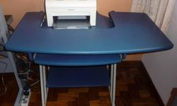 Blue wooden computer or printer table to let go. It