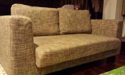 One year old customized fabric sofa. In good condition