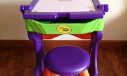 Used. Stool included. This multi-purpose art studio