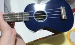 �Dark blue ukelele for sale! �Used less than a year,