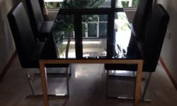 Selling Designer Glass Dining Table Black with 4 Chairs