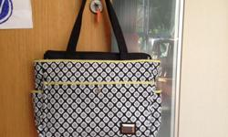 Brand new diaper bag with foldable changing mat