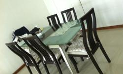 150CM tamper Glass top dining table with six chairs.