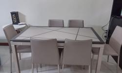 Used Dining table +6 chairs in excellent condition,