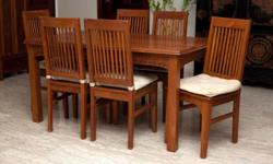 Indonesian wood dining table and 6 chairs including