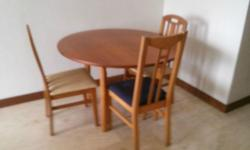 1.15 metres diameter timber dining table and 3 nos of