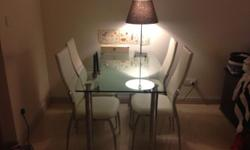 Very good condition Dining table and 4 dining chairs.