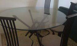 Moving out sale. Dinnig table - Glass top 4 metal