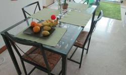 We are selling our dining table inclusive of 4 chairs.