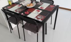 Brown Dining Table (IKEA) with four chairs.