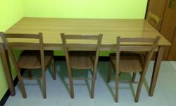 I'm selling a wooden dining table with 6 chairs in very