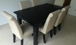 Dining table with 2 inbuilt drawers and 6 chairs. Table